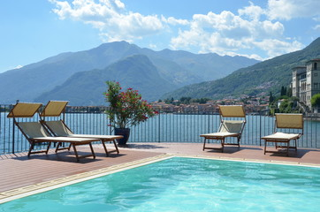 Row of sunbeds against Como lake, Italy