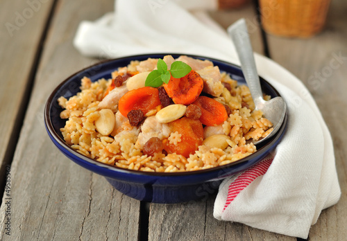 Chicken with Dried Fruit and Nuts on Pasta