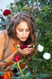 beautiful woman in garden with roses