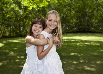 Two Young Girls in White Dresses