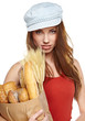 beautiful young woman with vegetables and fruits in shopping bag