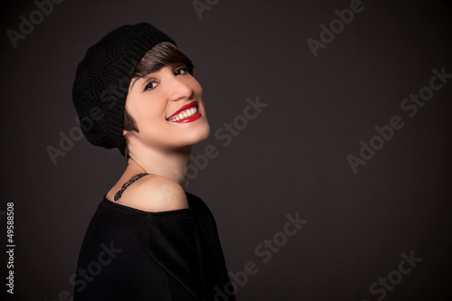 Smiling girl with french style outfit and copy space