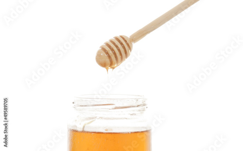 honey and honey stick over white