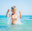 Young boy swimming in sea