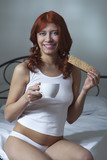 woman drink coffee and eat toast in bed