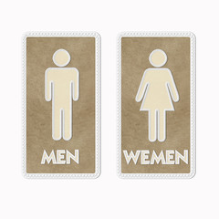 Stitched Man & Woman restroom sign on leather background
