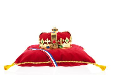 Golden crown on velvet pillow with Dutch flag