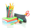 pencil box with school equipment isolated on white