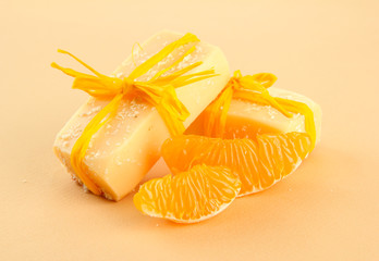 Natural handmade soap and orange, on beige background