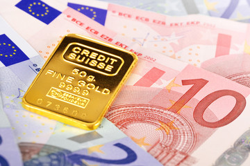 Composition with Euro banknotes and Swiss gold bar