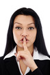Pretty businesswoman with silence sign