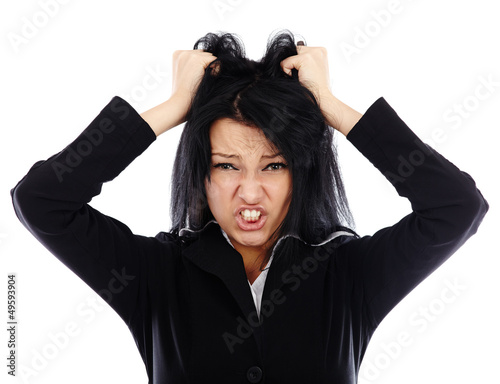 Portrait of an angry businesswoman pulling her hair