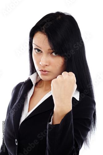 Threatening businesswoman showing her fist