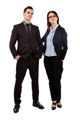 Young business partners looking at camera in full length pose