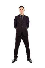 Young businesman looking at camera in full length pose