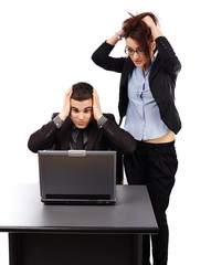 Young businesspeople having trouble with their laptop