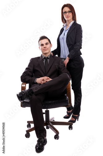 Businesswoman and businessman in full length pose