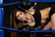 Sports Boxing Woman in black box gloves in fitness gym
