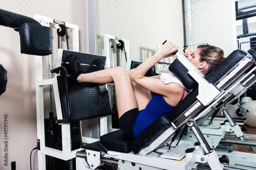 Woman using a leg press machine