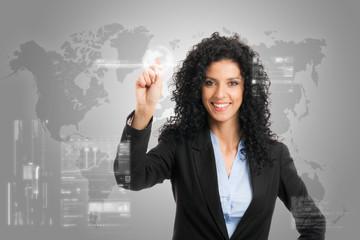 Businesswoman touching a digital control panel