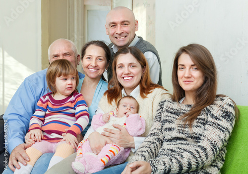 Portrait of cheerful three generations family