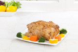 Eatable whole roasted chicken served with vegetable poster