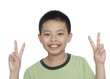Smile little boy holding up the peace sign,