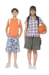 Full length two adorable children with balls