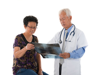 chinese senior doctor with patient