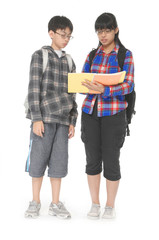 Two students with school bags on their shoulders posing
