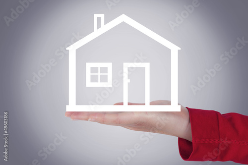 Woman hands holding house