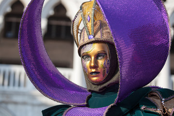 purple and gold carnival mask in Venice 2013