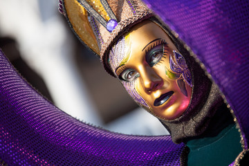 purple and gold carnival mask in Venice