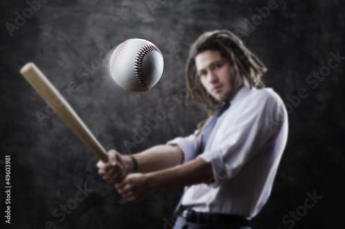 Businessman swinging baseball bat