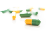 tablets capsules pills yellow green isolated