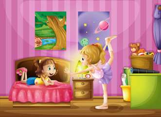 Two young girls inside a bedroom