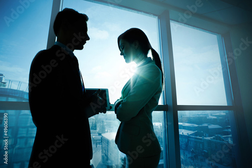 Colleagues by the window