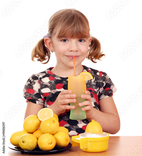 beautiful little girl drink lemonade