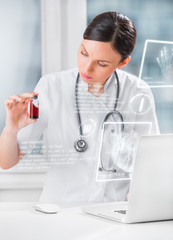 Portrait of pretty female laboratory assistant analyzing a blood