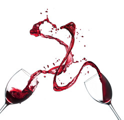 Concept of red wine splashing from glasses on white background