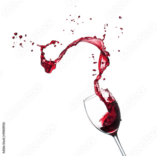 Foto op Canvas Bar Red wine splashing from glass, isolated on white background