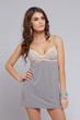 Brunette posing in a grey nightgown