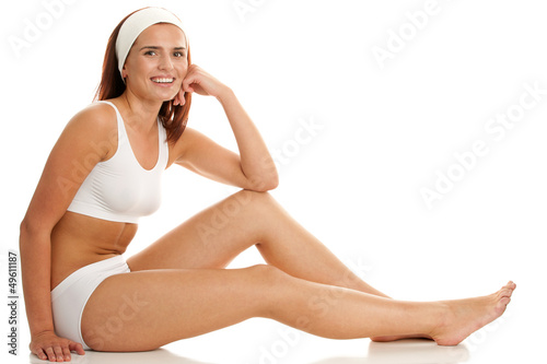 Woman sitting on white background