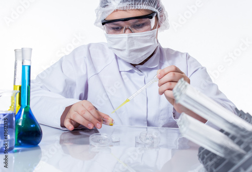 laboratory assistant analyzing a sample