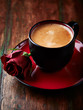 Cup of espresso with red rose
