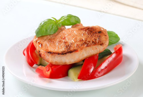Pork cutlet with red pepper and zucchini sticks