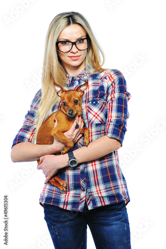 Cute young girl smiling while holding her puppy isolated on whit