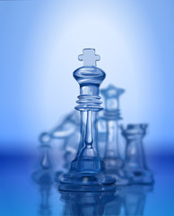 Chess figures, led by King on a blue background