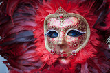 Close up of  red carnival mask with blu eyes in Venice, Italy
