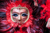 Close up of red carnival mask in Venice, Italy